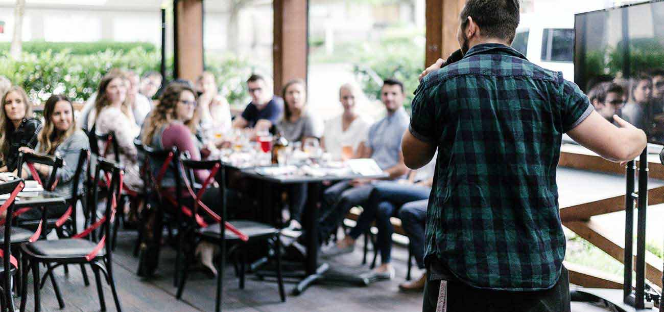 Man using community involvement marketing to talk to a group of people