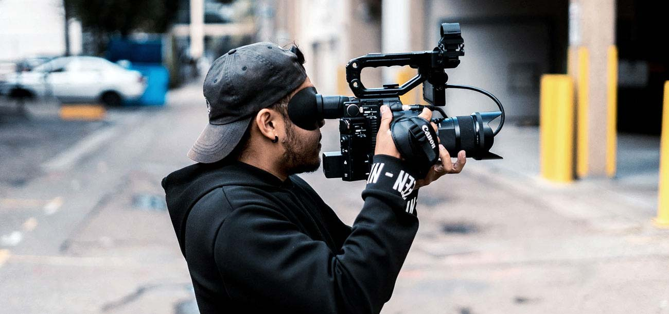 Man using camera for video content marketing